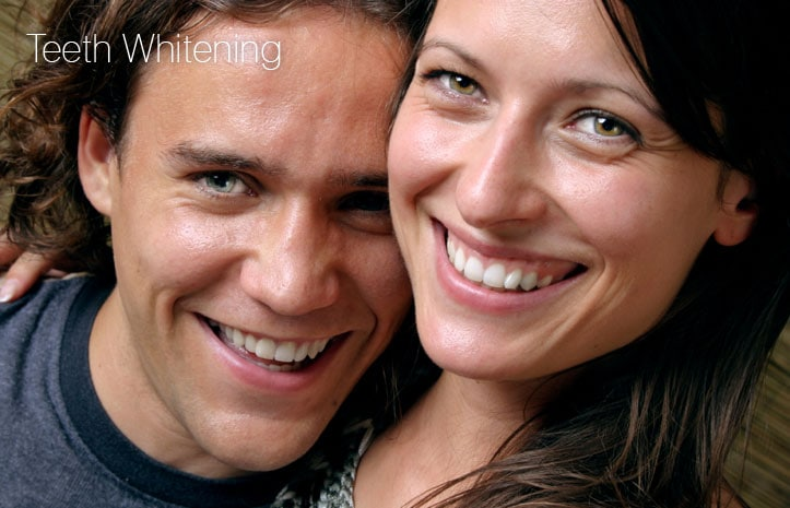 Couple smiling after teeth whitening treatment