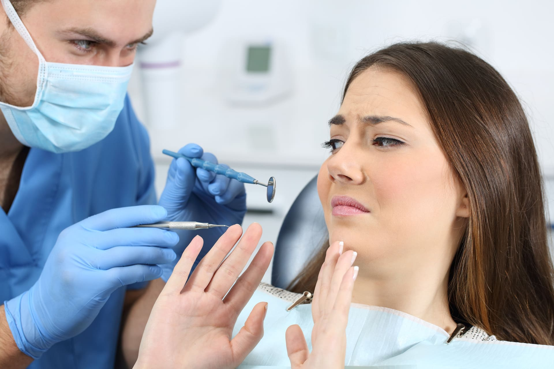 A person with denotphobia in a dentist chair